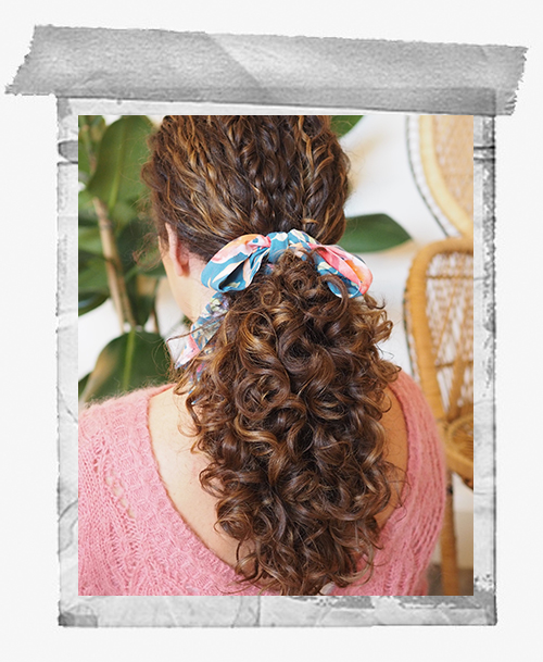 curly hair styles low pony tail