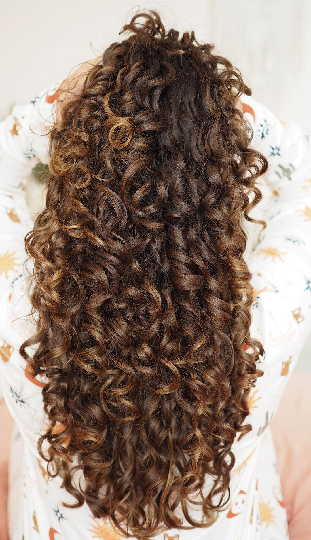 long curly hair with balayage highlights